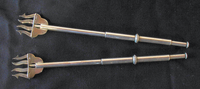 Two protractible silver lyre-shaped pickle forks